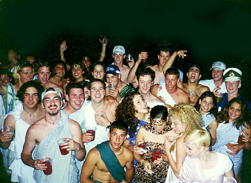 "At a ""Toga Party."" Ian is in the back right with his friends Kate and Justin"