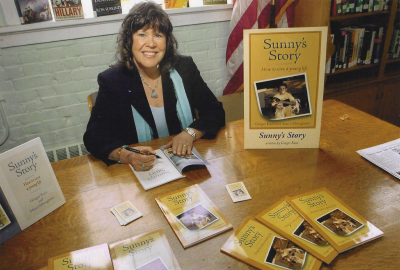 Ginger Katz signs autographed copies of one of her substance abuse books